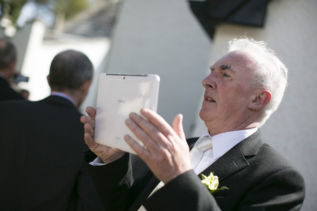 wedding guest taking picture with ipad