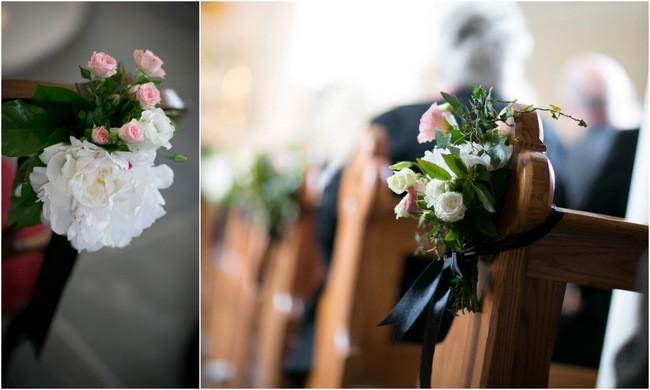 flower pew ends with black ribbons