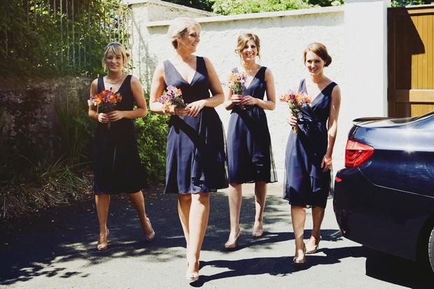 Bridesmaids in short navy dresses