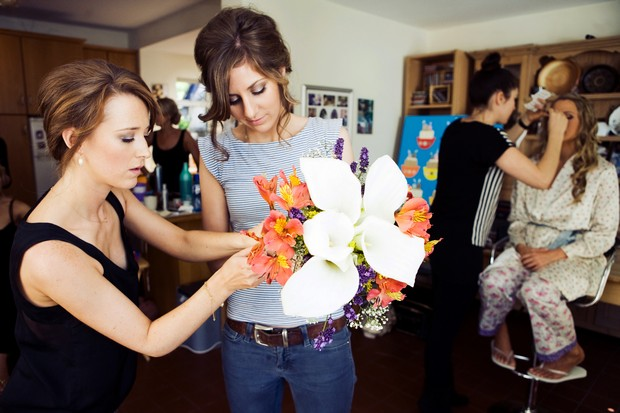 Bridesmaids inspecting wedding bouquet
