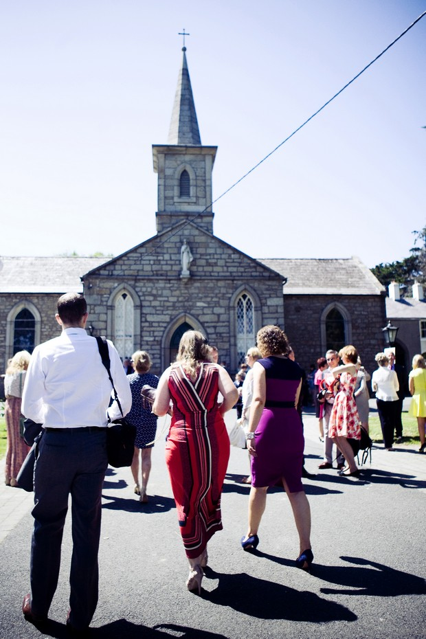 wedding guests gathered outside chruch
