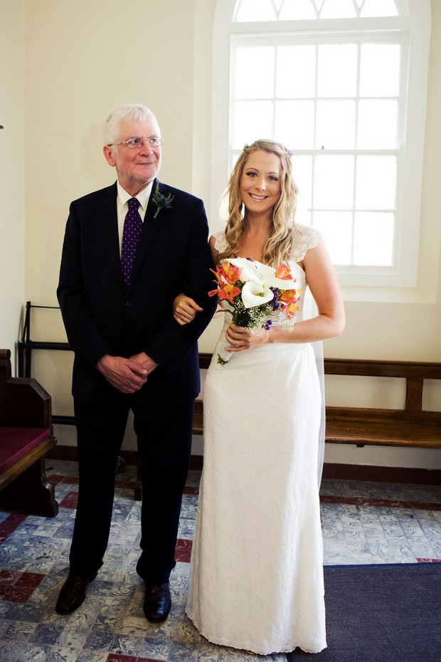 bride and dad beginning to walk up aisle