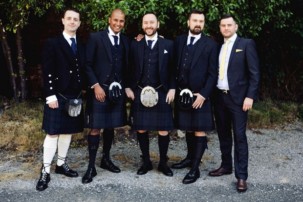 groomsmen in navy kilts