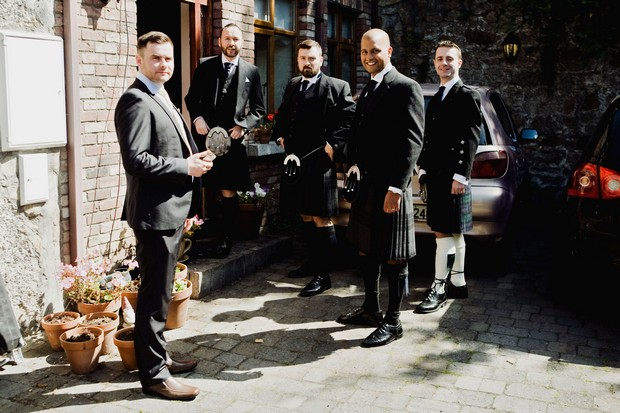 Groomsmen in kilts getting ready wedding