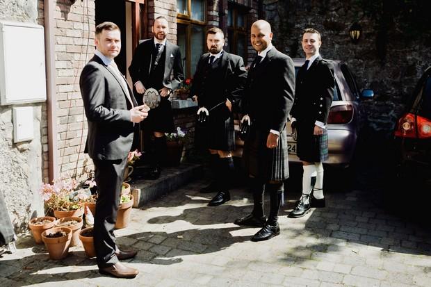 Groomsmen in kilts getting ready wedding