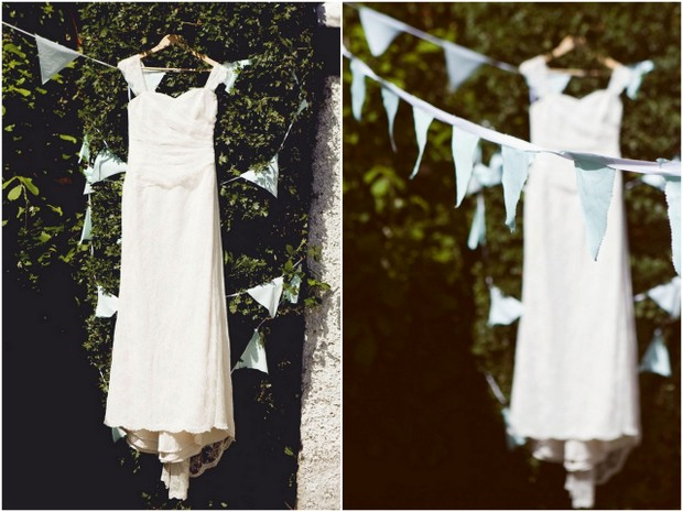 Wedding dress hanging up with bunting