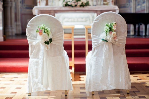 ceremony bride and groom chair back decor flowers