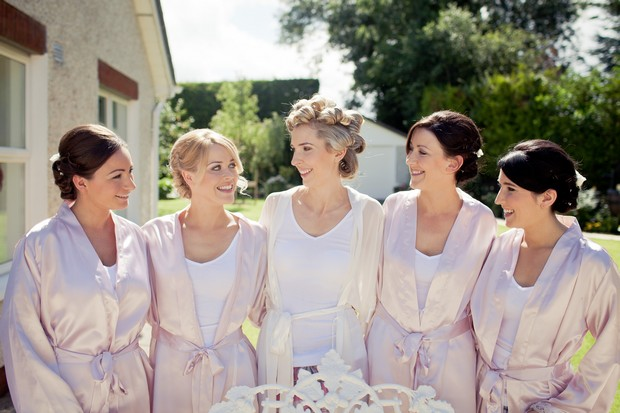 bridesmaids in pink silk robes