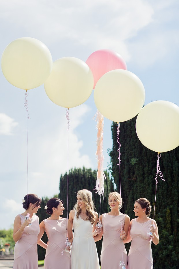 pink white oversized balloons wedding photo