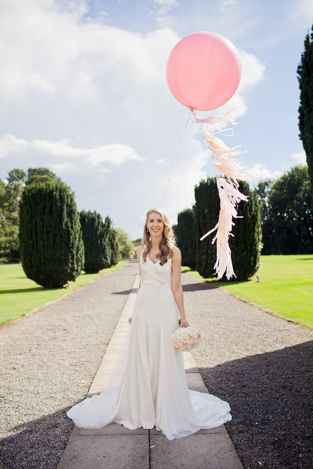 pink white oversized balloons wedding photo bride