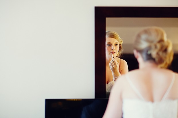 bride-in-mirror-doing-make-up