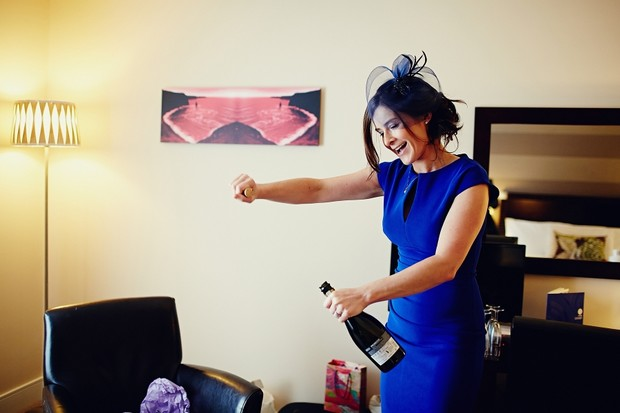 bridesmaid-opening-champagne-getting-ready