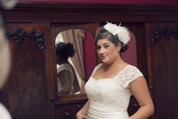 bride in feather fascinator