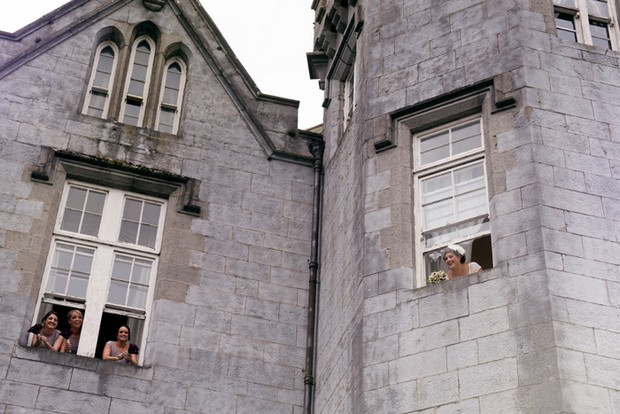 bride bridesmaids in window