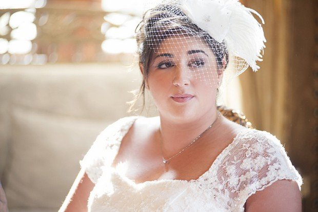 bride in net and feather fascinator