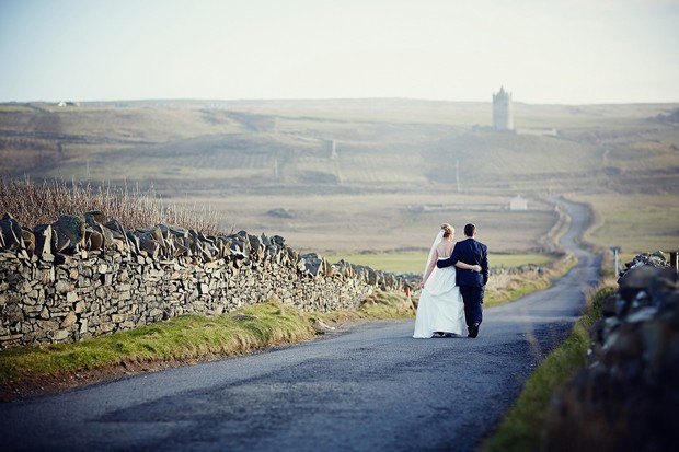 bride-groom-walking-road-ireland-wedding
