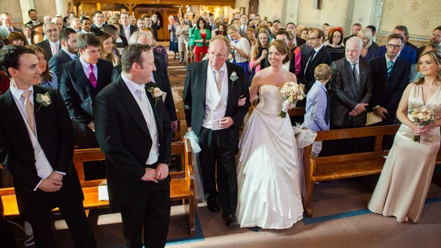 father of the bride giving away top of aisle