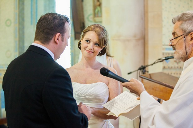 bride and groom exchange vows in chruch
