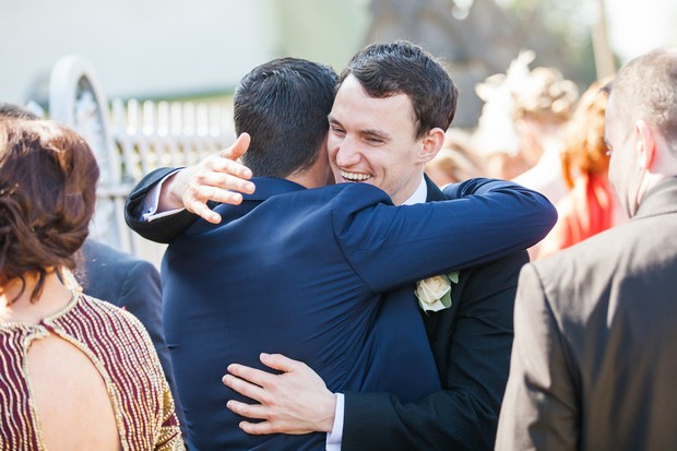 groomsmen hugging outside church