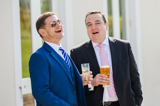 wedding guests laughing in the sun