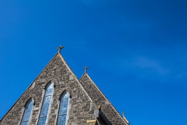 photo of church with blue sky sunny wedding