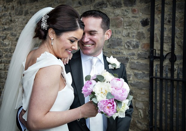 bride with light pink and white wedding bouquet