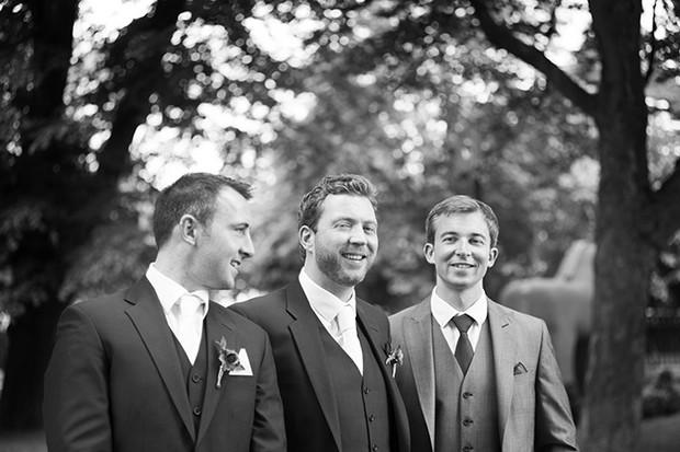 black and white groomsmen photo outdoors