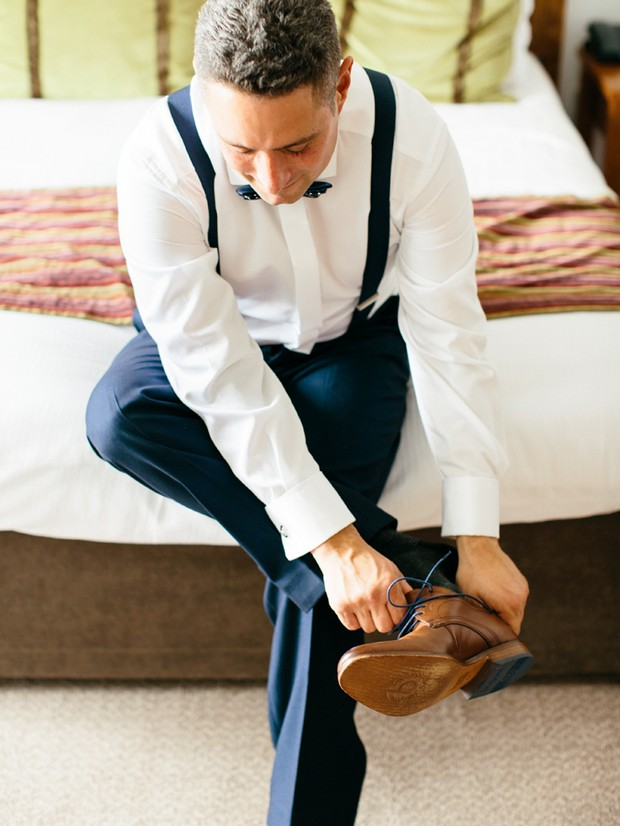 groom getting ready brown shoes navy suit