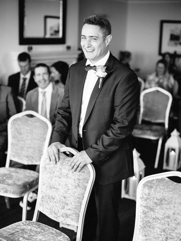 groom laughing wedding ceremony