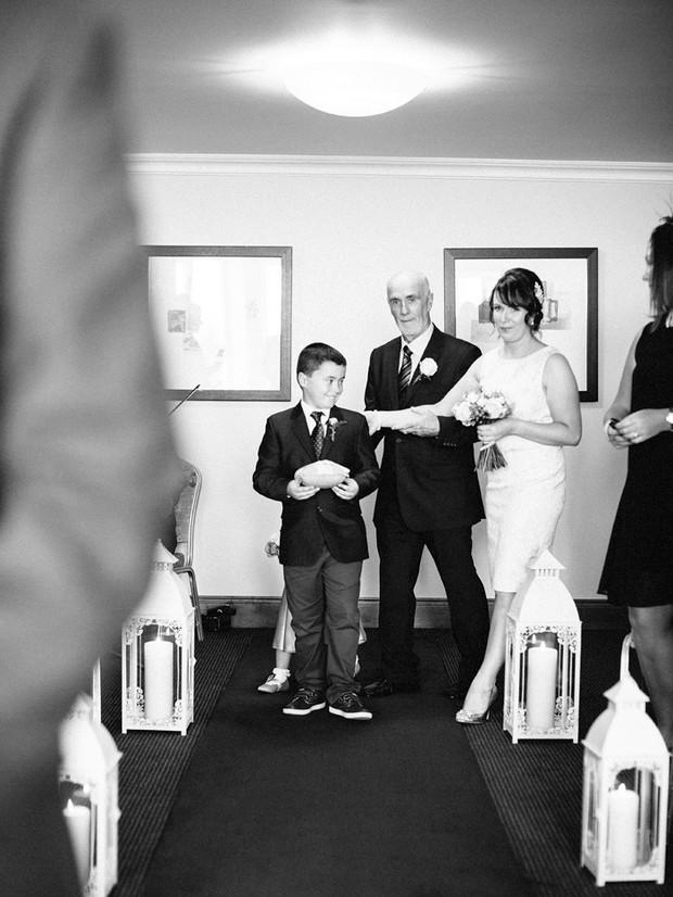 black and white bride walking up aisle