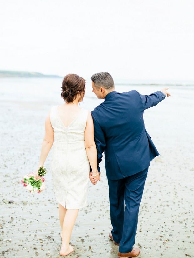 bride groom walking on beach hand