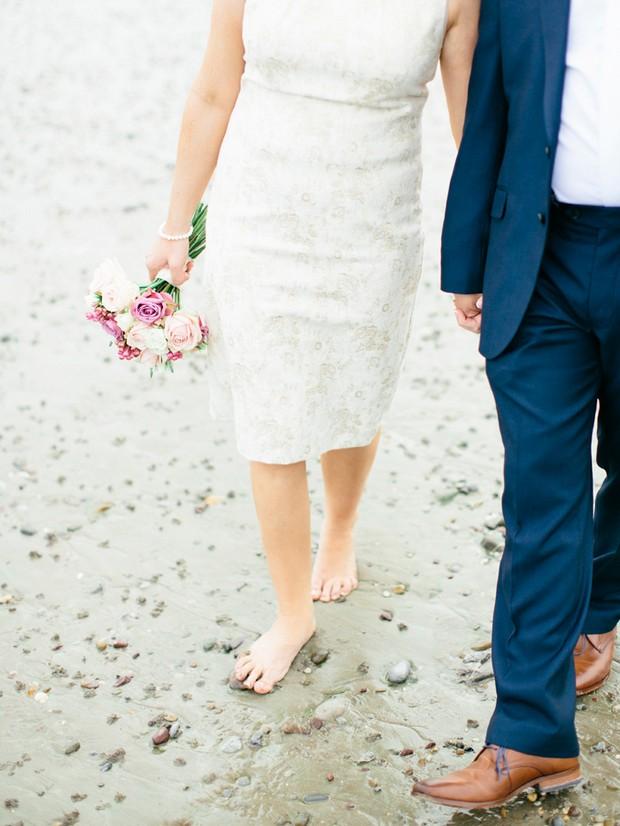 bride groom walking beach short dress