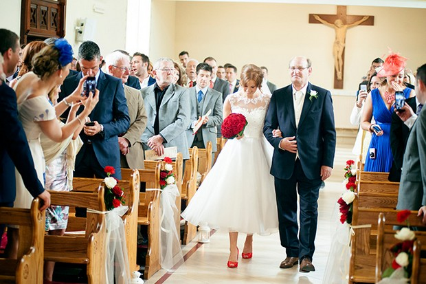 bride with red shoes red rose bouquet