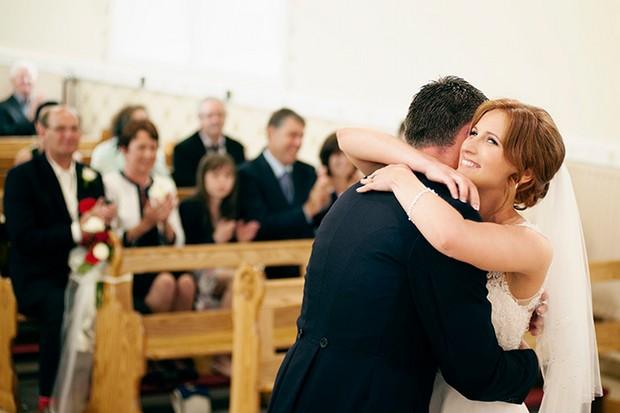 wedding ceremony bride groom hug