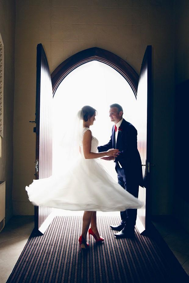 bride twirling in tea length wedding dress