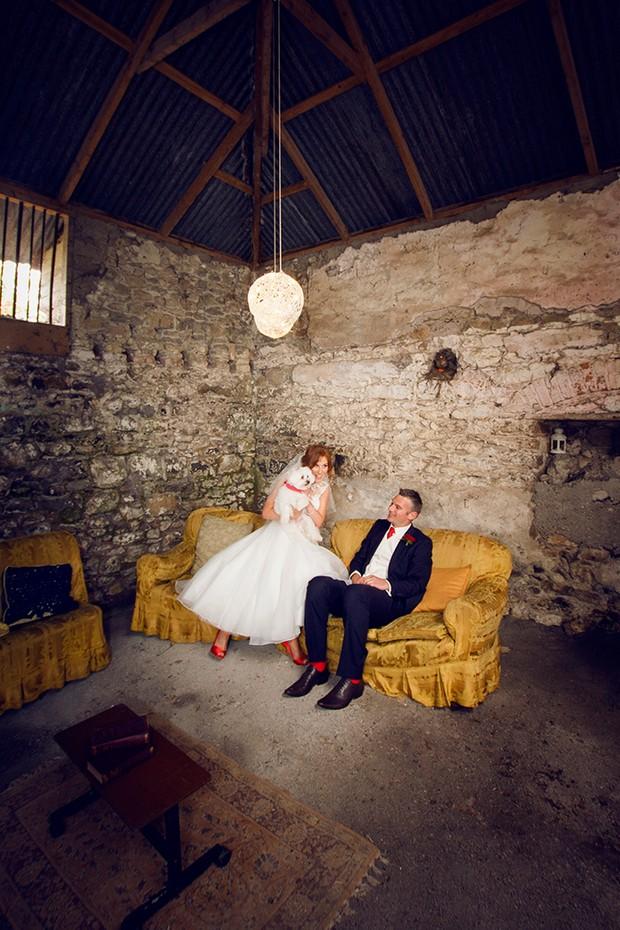 barn wedding couple retro sofas