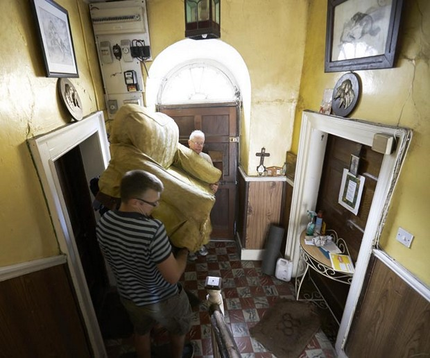 renovating house men moving sofa