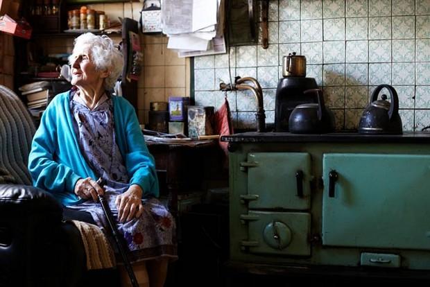 portrait of elderly woman in kitchen