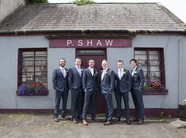 groomsmen outside old irish pub wedding