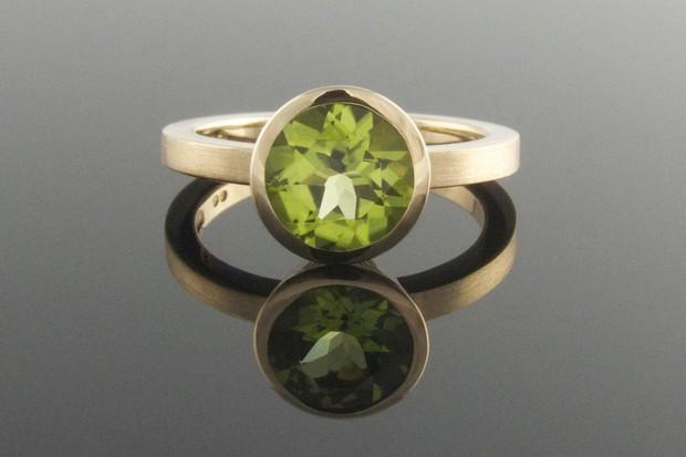 Bezel-set-peridot-engagement-ring-9ct-yellow-gold