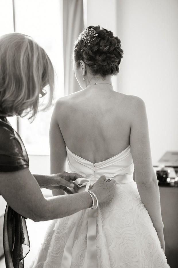bride in tara keely wedding dress