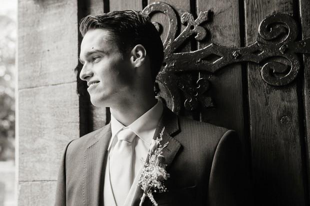 handsome groom at church door