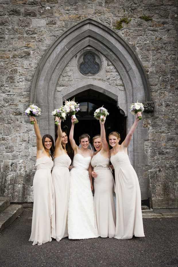 bridesmaids in champagne long dresses