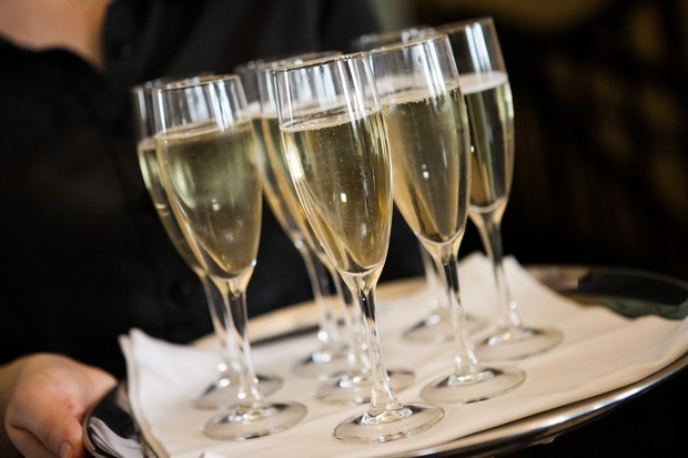glasses of champagne on serving tray