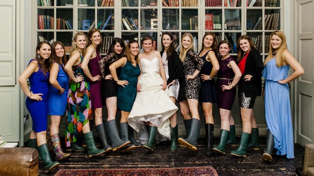 bride and female guests in wellies