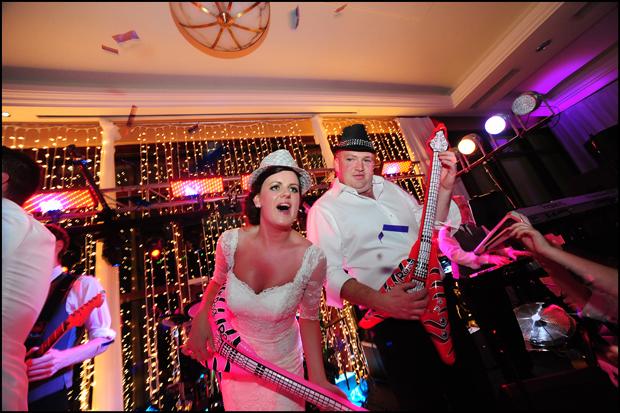 real-wedding-trim-castle-bride-groom-air-guitars