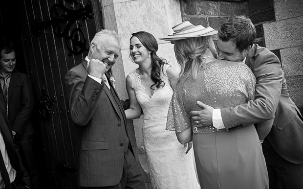 tara-john-wedding-greeting-guests-church