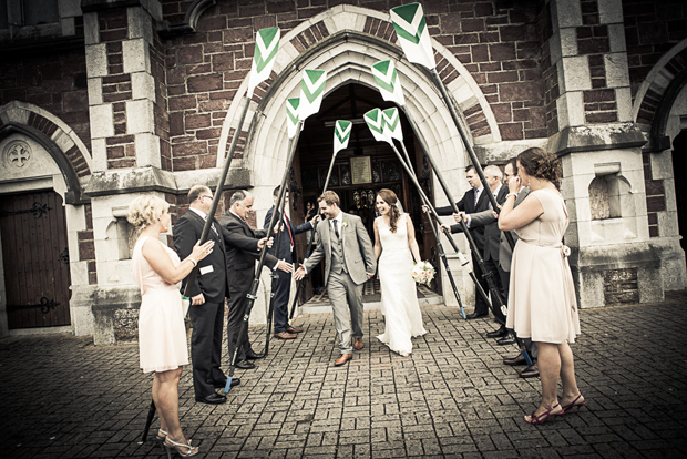 tara-john-wedding-paddles-exit-church