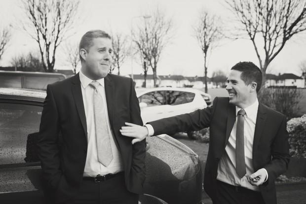 fun black white photo groom best man