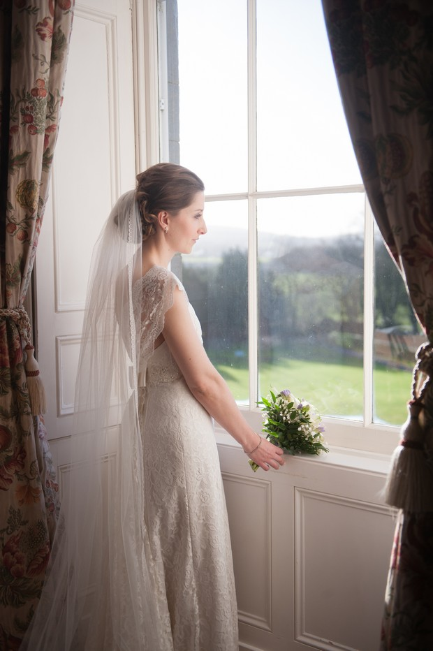bride pensive at a window